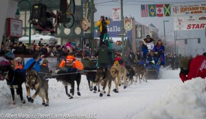 Leaving the Ceremonial Start on 4th Avenue, 2013 Iditarod. Photo by Albert Marquez/Planet Earth Adventures, LLC