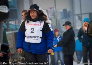 Martin Buser at the Ceremonial Start on 4th Avenue, Iditarod 2013. Photo by Albert Marquez/Planet Earth Adventures, LLC
