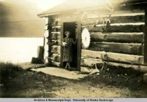 Alaska Nellie at her cabin on Kenai Lake, circa 1941-45. [Arthur O. Trosvik Collection, University of Alaska Consortium Library Special Collections UAA-HMC-0503]