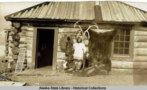 Alaska Nellie Lawing, at her Kenai Lake log cabin. [Alaska State Library Fred Henton Collection  AMRC-b65-18-741]