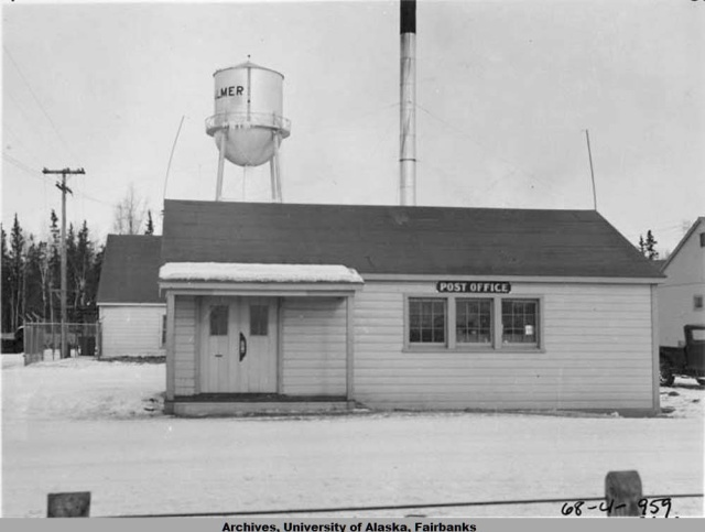 The iconic Palmer water tower behind Palmer's second post office, 1935. [Willis T. Geisman, 1935]