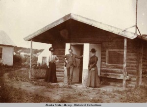 Mr. and Mrs. Wickersham (right) and woman friend in front of the Eagle cabin built by Judge Wickersham in 1900. [Alaska State Library P277-019-022]